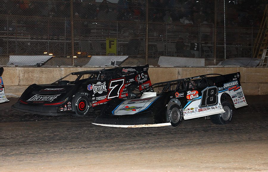 Chase Junghans (18) races alongside Ricky Weiss during Saturday's Wild West Shootout feature at Arizona Speedway. (Mike Ruefer Photo)
