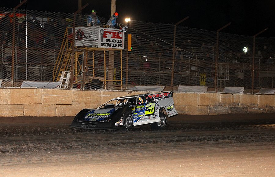 Brian Shirley takes the checkered flag to win Saturday's Wild West Shootout opener at Arizona Speedway. (Mike Ruefer Photo)