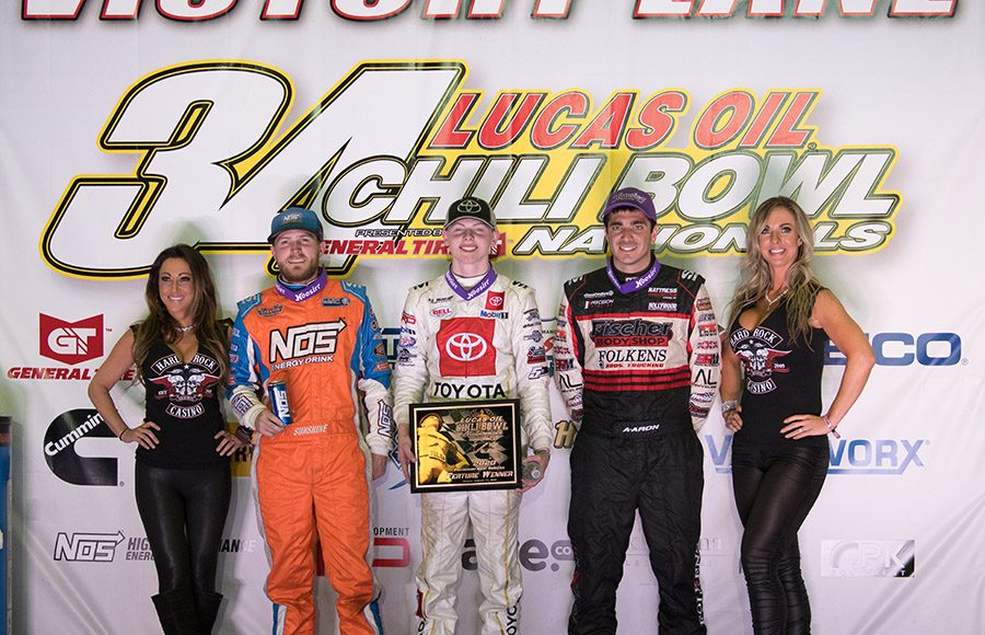 Cannon McIntosh (center) bested Tyler Courtney (left) and Aaron Reutzel (right) to win Monday's Chili Bowl qualifying feature in Tulsa, Okla. (Devin Mayo Photo)