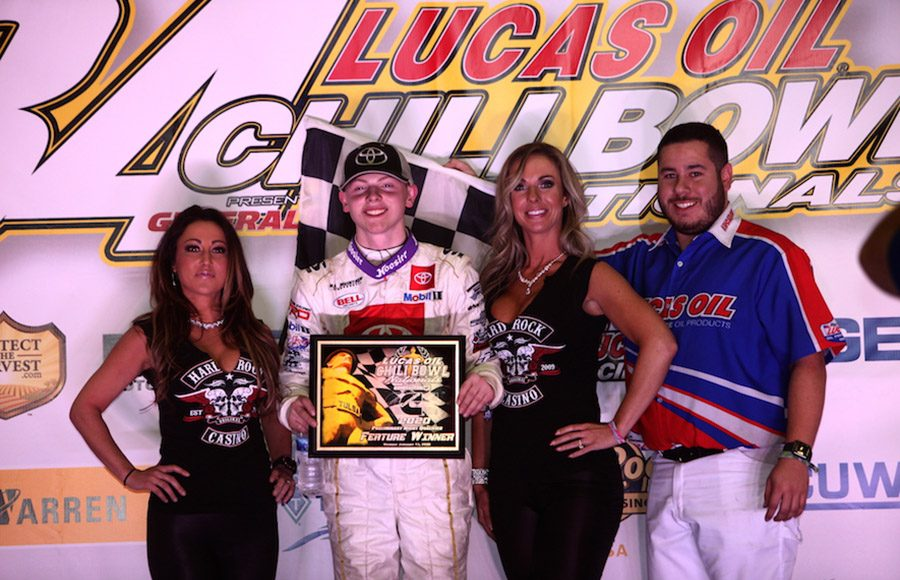 Cannon McIntosh poses in victory lane after winning Monday's Lucas Oil Chili Bowl qualifying feature at Tulsa (Okla.) Expo Raceway. (Richard Bales Photo)
