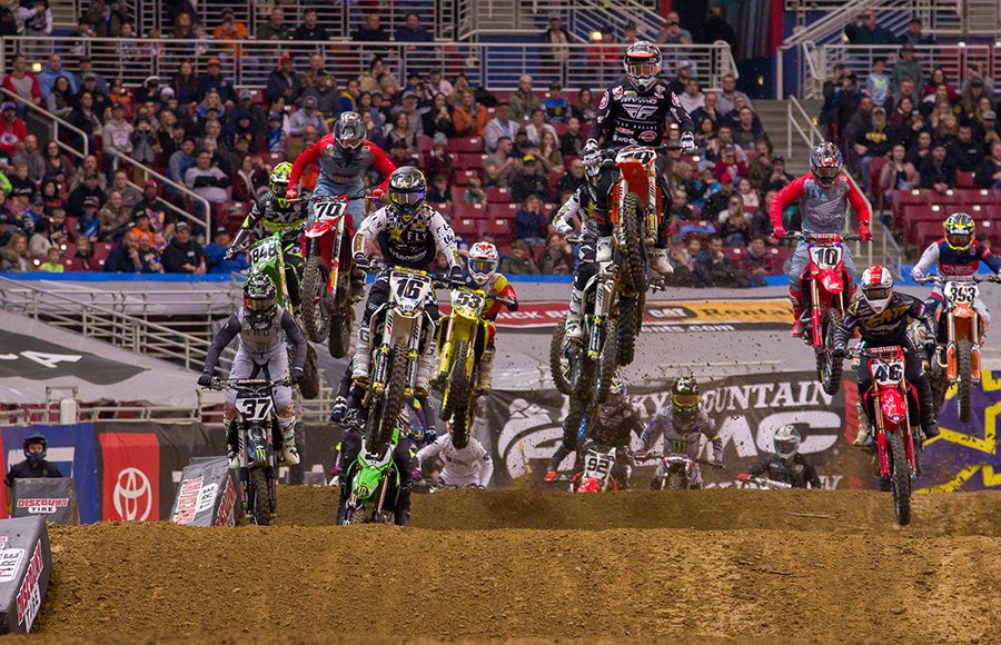 Riders battle for position as they go over jumps during Saturday's Supercross event in St. Louis, Mo. (Darren Rutmanis Photo)