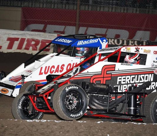 Jonathan Beason (8) battles Kyle Larson for the race lead during Tuesday's Warren CAT Qualifying Night Chili Bowl feature at Tulsa Expo Raceway. (Frank Smith Photo)