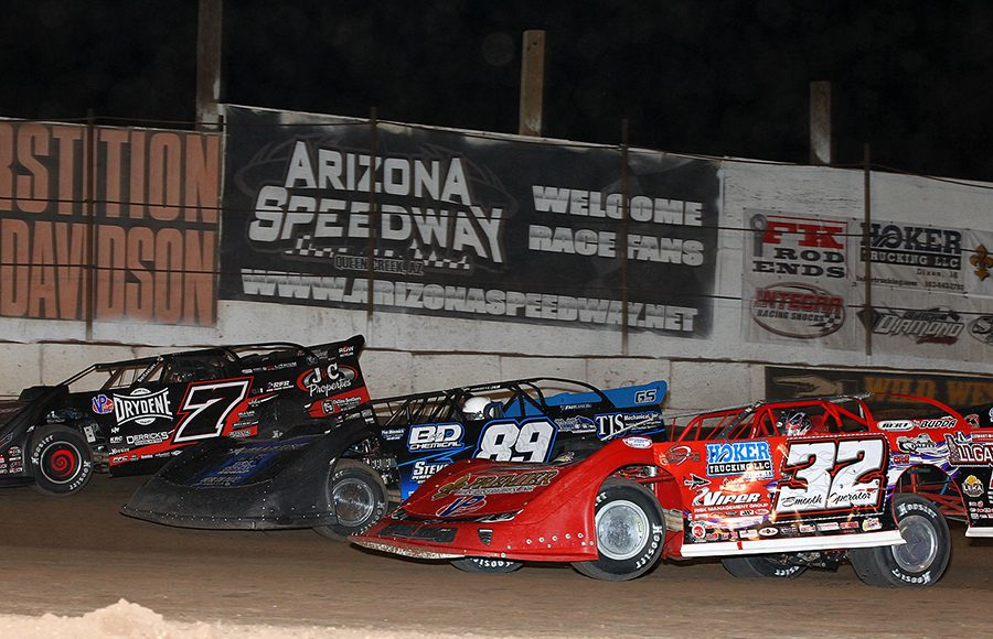Bobby Pierce (32), Mike Spatola (89) and Ricky Weiss race three-wide during Sunday's Wild West Shootout event at Arizona Speedway. (Mike Ruefer Photo)