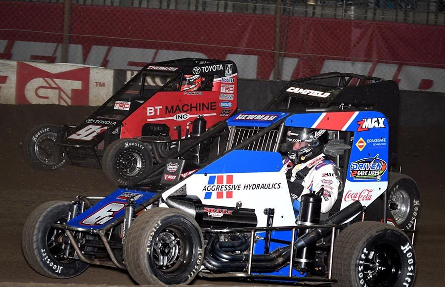 Ryan Newman (6), David Camfield (16) and Tyler Thomas battle three-wide during Wednesday's Chili Bowl preliminary feature at Tulsa Expo Raceway. (Frank Smith Photo)