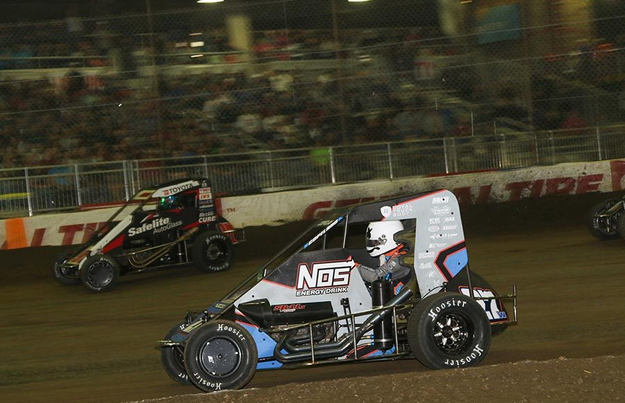 Rico Abreu (97) races around the outside of Colby Copeland during Wednesday's Chili Bowl preliminary feature at Tulsa Expo Raceway. (Brendon Bauman Photo)