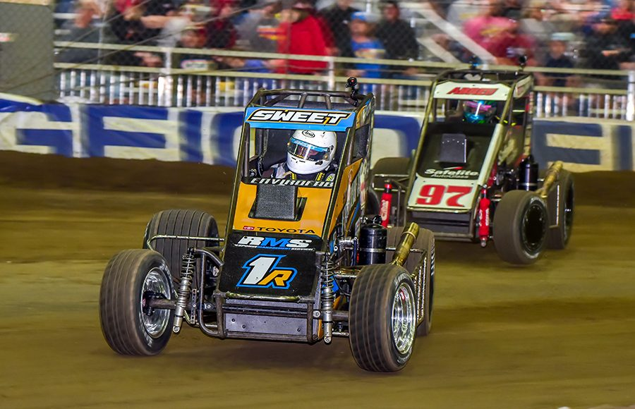 Brad Sweet (1R) leads Rico Abreu during Wednesday's Chili Bowl preliminary feature at Tulsa Expo Raceway. (Mark Coffman Photo)