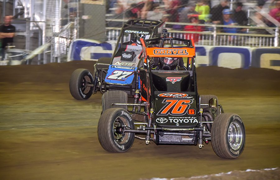David Gravel (76) battles ahead of Colby Copeland during Wednesday's Chili Bowl preliminary feature at Tulsa Expo Raceway. (Mark Coffman Photo)