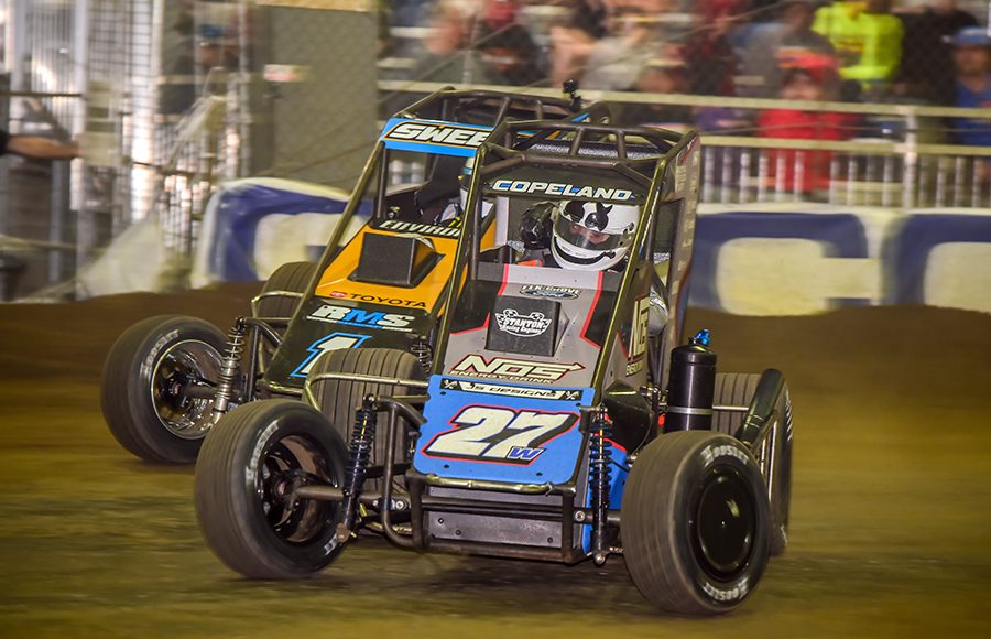 Colby Copeland (27) races ahead of Brad Sweet during Wednesday's Chili Bowl preliminary feature at Tulsa Expo Raceway. (Mark Coffman Photo)