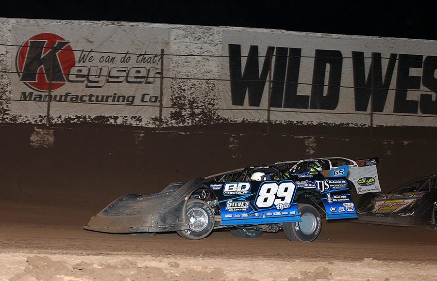 Mike Spatola (89) battles alongside Brian Shirley during Wednesday's Wild West Shootout event at Arizona Speedway. (Mike Ruefer Photo)