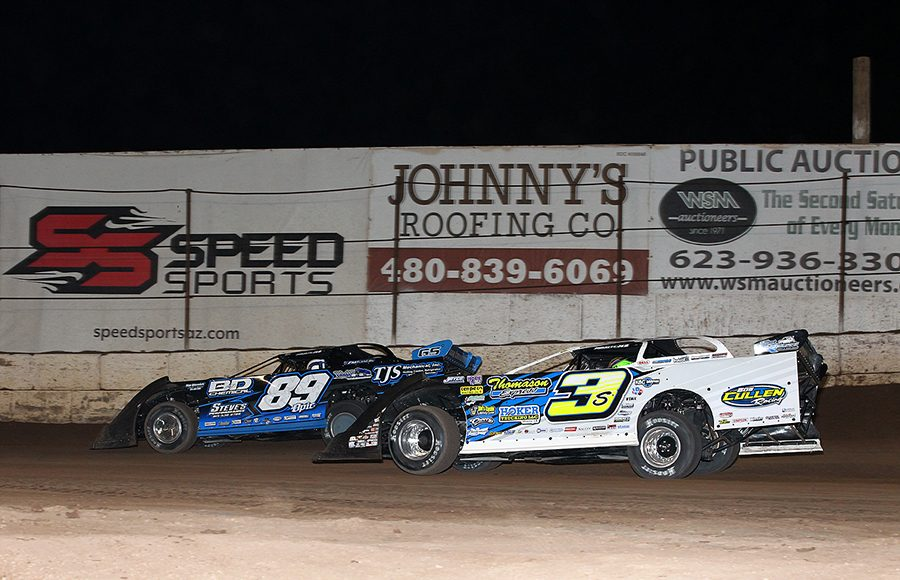 Brian Shirley (3s) races under Mike Spatola during Wednesday's Wild West Shootout event at Arizona Speedway. (Mike Ruefer Photo)