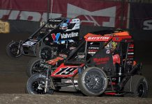 Spencer Bayston (19), Jason McDougal (76) and C.J. Leary race three-wide during Thursday's Chili Bowl preliminary feature at Tulsa Expo Raceway. (Frank Smith Photo)