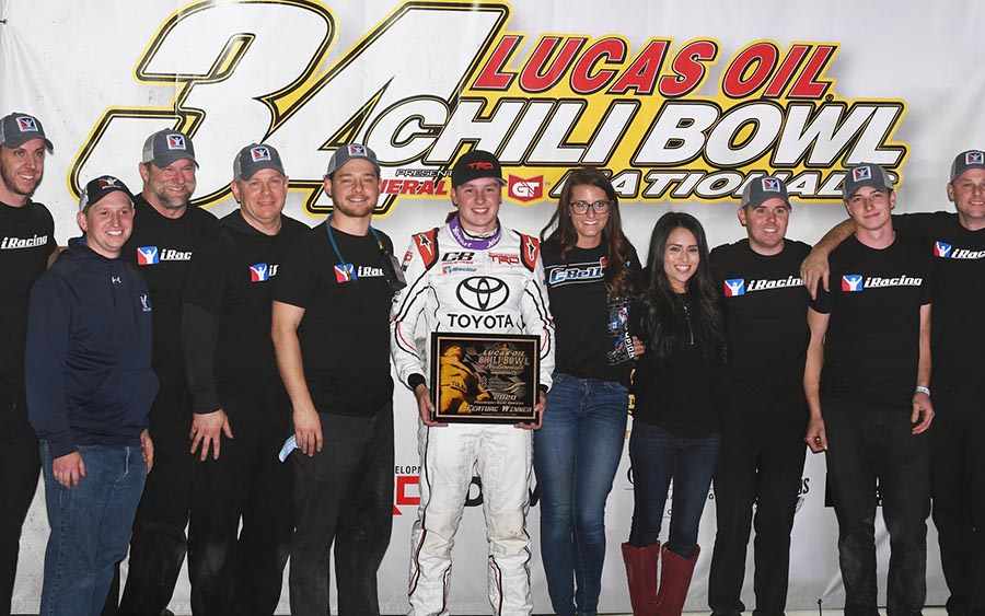 Christopher Bell poses in victory lane with his Tucker-Boat Motorsports crew after winning Thursday's Chili Bowl preliminary feature at Tulsa Expo Raceway. (Frank Smith Photo)