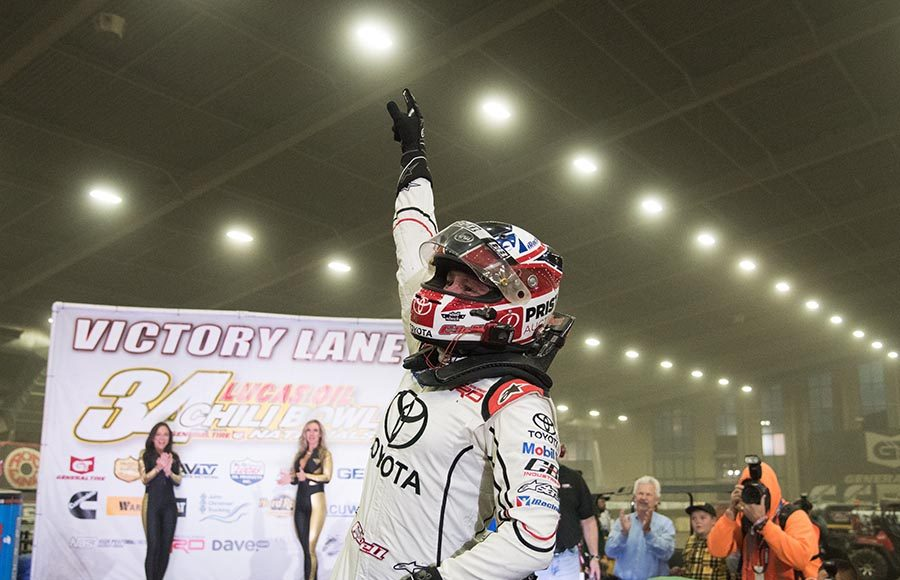 Christopher Bell celebrates after winning Thursday's Chili Bowl preliminary feature at Tulsa Expo Raceway. (Devin Mayo Photo)