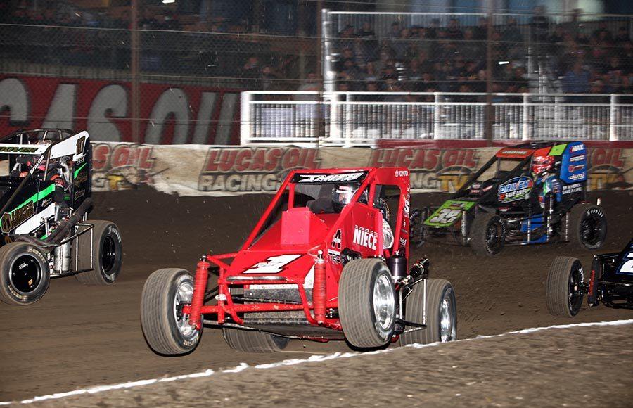 Mark Smith pops a wheelie during preliminary action on Thursday evening at Tulsa Expo Raceway. (Richard Bales Photo)