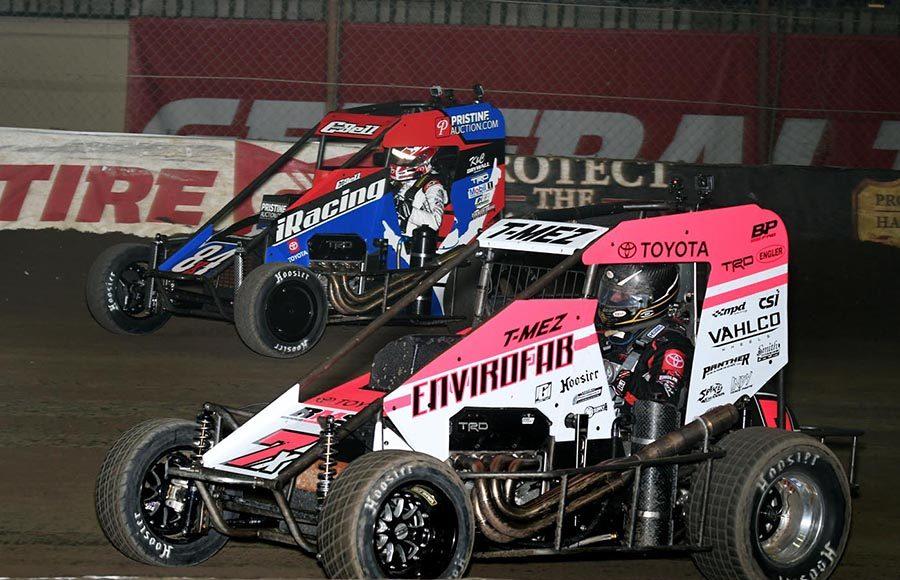 Thomas Meseraull (7x) races alongside Christopher Bell during Thursday's Chili Bowl preliminary feature at Tulsa Expo Raceway. (Frank Smith Photo)