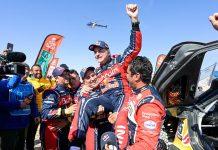Carlos Sainz gets lifted in the air after clinching his third Dakar Rally title. (Dakar Rally Photo)