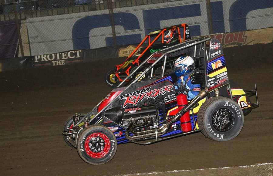 Justin Allgaier (7) battles A.J. Hopkins during Friday's Chili Bowl qualifying event at Tulsa Expo Raceway. (Brendon Bauman Photo)