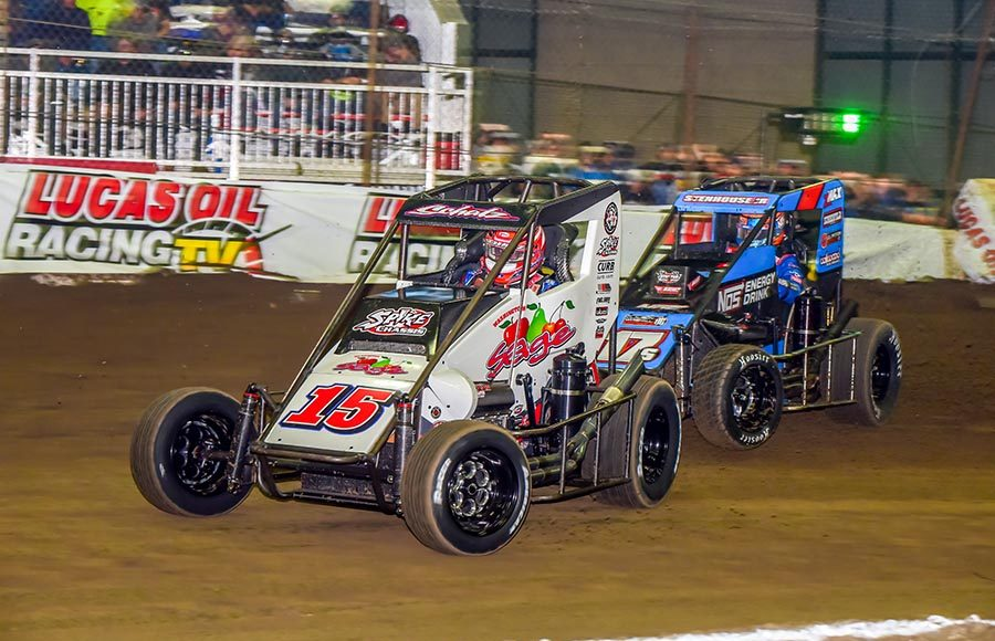 Donny Schatz (15) races ahead of Ricky Stenhouse Jr. during Friday's Chili Bowl preliminary event at Tulsa Expo Raceway. (Mark Coffman Photo)