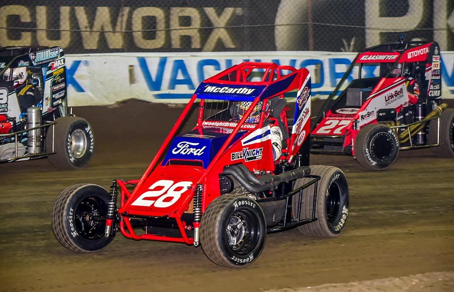 Ace McCarthy (28) rides the bottom line during Friday's Chili Bowl preliminary event at Tulsa Expo Raceway. (Mark Coffman Photo)