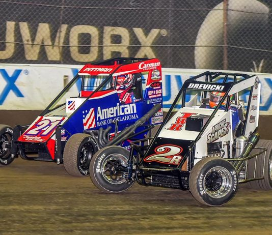 Steven Drevicki (2) races under Daryn Pittman during Friday's Chili Bowl preliminary event at Tulsa Expo Raceway. (Mark Coffman Photo)