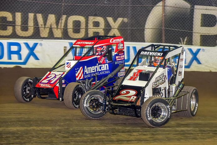 Steven Drevicki (2) races under Daryn Pittman during Friday's Chili Bowl preliminary event at Tulsa Expo Raceway. (Mark Coffman Photo)