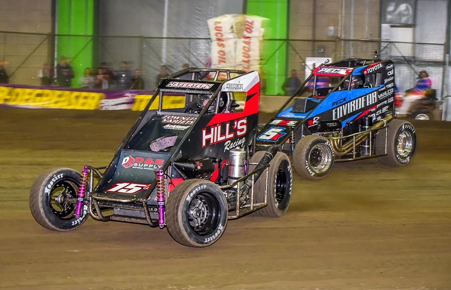 Sam Hafertepe Jr. (15) leads Justin Peck during Friday's Chili Bowl preliminary event at Tulsa Expo Raceway. (Mark Coffman Photo)