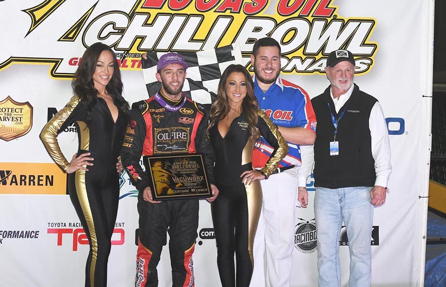 Tanner Thorson poses in victory lane after winning Friday's Chili Bowl preliminary feature at Tulsa Expo Raceway. (Frank Smith Photo)