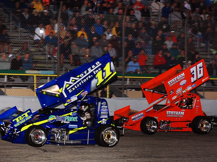 Joey Aguilar (11) leads Troy DeCaire during Saturday's outhern Sprint Car Shootout Series feature at 417 Speedway. (David Sink Photo)