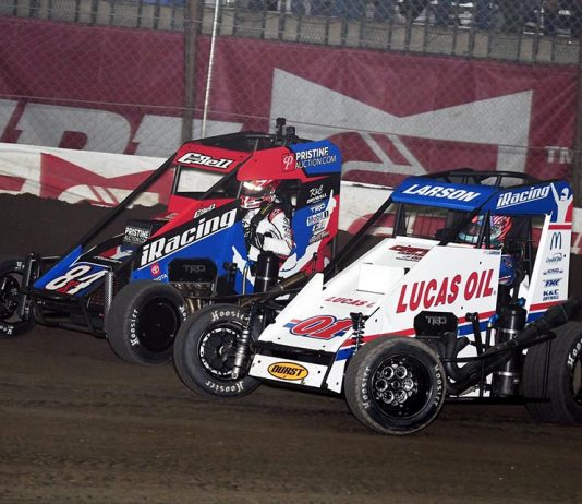 Kyle Larson (01) battles Christopher Bell for the race lead during Saturday's Chili Bowl finale at Tulsa Expo Raceway. (Frank Smith Photo)