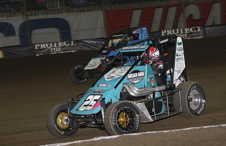 Chad Boespflug (25P) races under Kaidon Brown during the alphabet soup portion of Saturday's Chili Bowl finale at Tulsa Expo Raceway. (Brendon Bauman Photo)