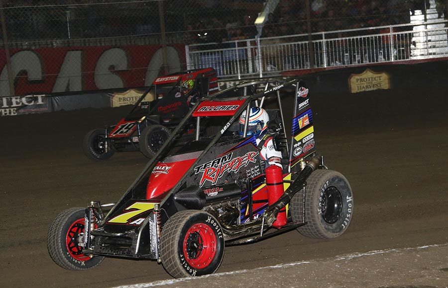 Justin Allgaier (7) races to the inside of Spencer Bayston during Saturday's Chili Bowl finale at Tulsa Expo Raceway. (Brendon Bauman Photo)