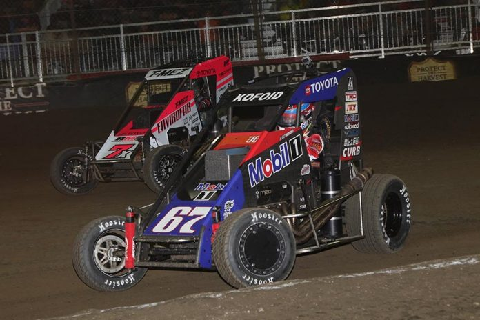 Buddy Kofoid (67) races under Thomas Meseraull during Saturday's Chili Bowl finale at Tulsa Expo Raceway. (Brendon Bauman Photo)