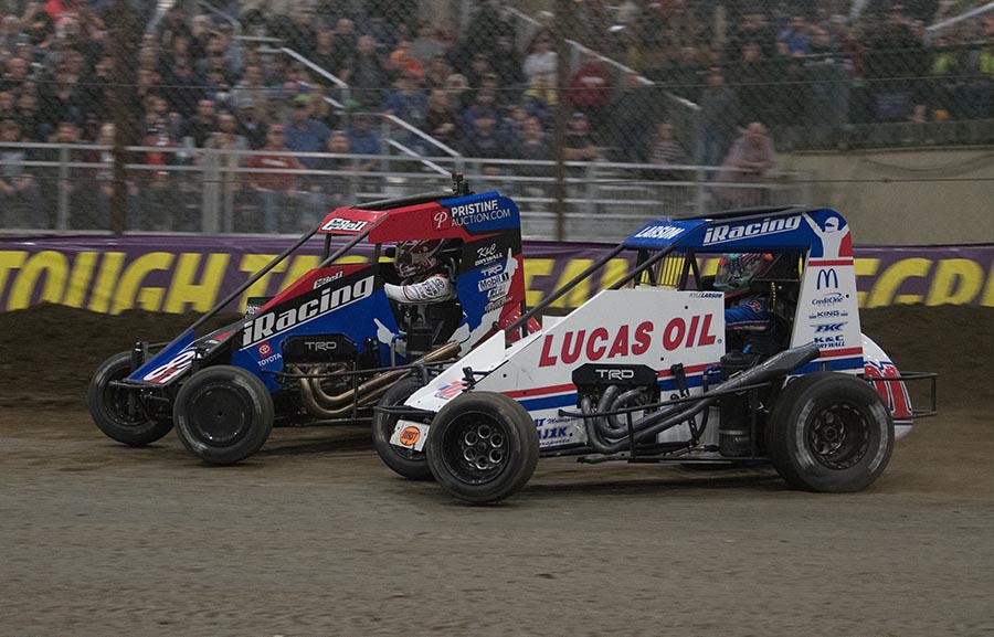 Kyle Larson (01) battles Christopher Bell for the race lead during Saturday's Chili Bowl finale at Tulsa Expo Raceway. (Devin Mayo Photo)