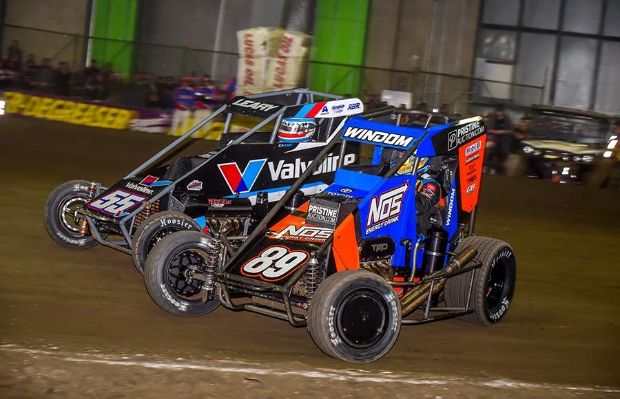 Chris Windom (89) races under C.J. Leary during Saturday's Chili Bowl finale at Tulsa Expo Raceway. (Mark Coffman Photo)