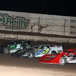 Cade Dillard (97), Brian Shirley (3s) and Johnny Scott race three-wide during Saturday's Wild West Shootout main event at Arizona Speedway. (Mike Ruefer Photo)