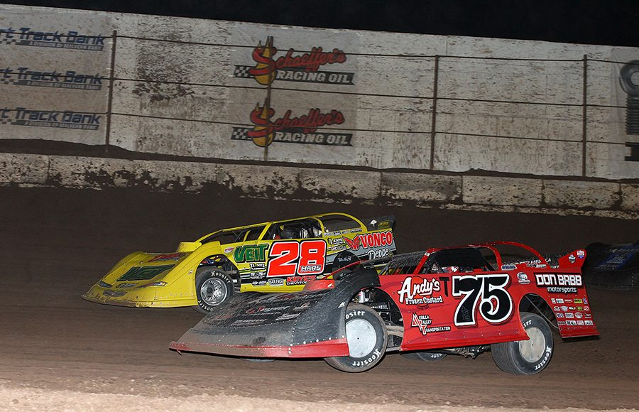 Terry Phillips (75) races under Jimmy Mars during Saturday's Wild West Shootout main event at Arizona Speedway. (Mike Ruefer Photo)