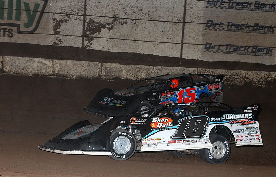 Chase Junghans (18) battles Brian Birkhofer during Saturday's Wild West Shootout main event at Arizona Speedway. (Mike Ruefer Photo)
