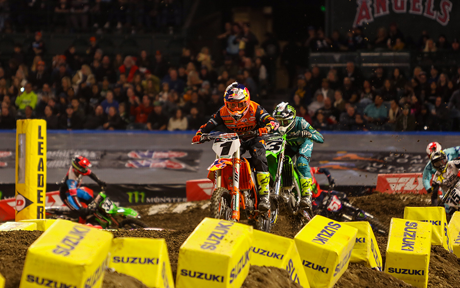 Cooper Webb (1) leads Eli Tomac during Saturday's Monster Energy AMA Supercross event in Anaheim, Calif. (Mark Munoz Photo)