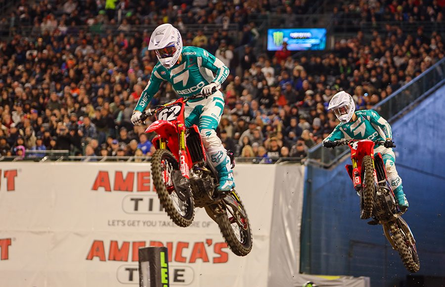 Christian Craig (62) races ahead of GEICO Honda teammate Jett Lawrence during Saturday's Monster Energy AMA Supercross 250 class event in Anaheim, Calif. (Mark Munoz Photo)
