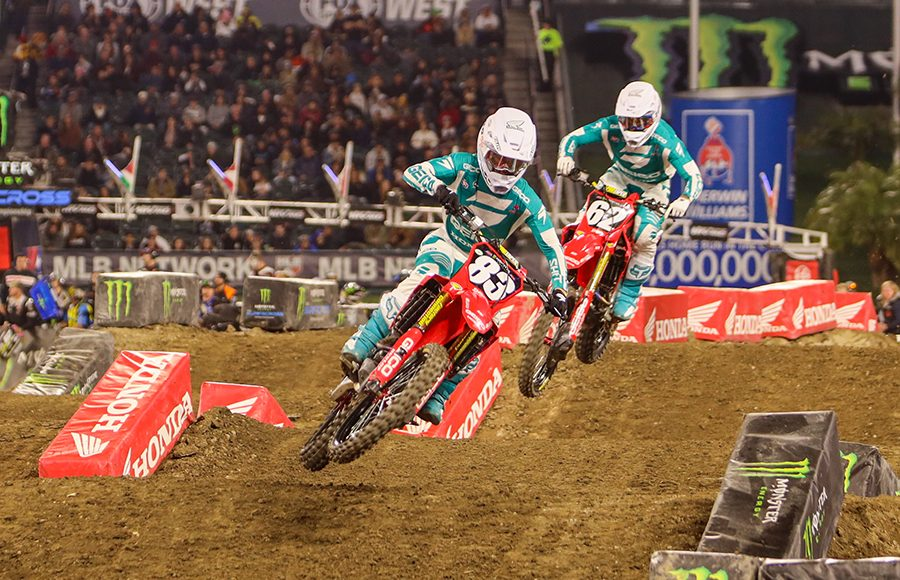 Jett Lawrence (83) leads GEICO Honda teammate Christian Craig during Saturday's Monster Energy AMA Supercross 250 class event in Anaheim, Calif. (Mark Munoz Photo)