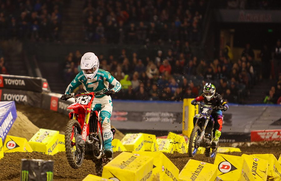 Jett Lawrence (83) races ahead of Dylan Ferrandis during Saturday's Monster Energy AMA Supercross 250 class event in Anaheim, Calif. (Mark Munoz Photo)