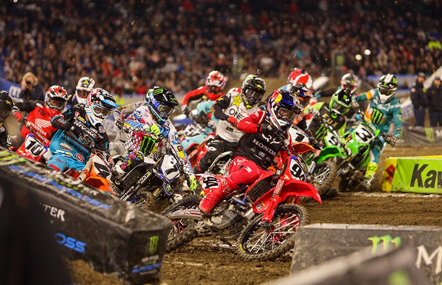 Ken Roczen (94) leads a hungry pack of 450 class riders through the opening corners of Saturday's Monster Energy AMA Supercross event in Anaheim, Calif. (Mark Munoz Photo)