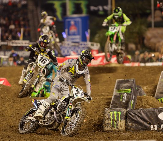 Jason Anderson (21) leads a group of riders during Saturday's Monster Energy AMA Supercross event in Anaheim, Calif. (Mark Munoz Photo)