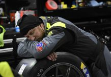 Crewman sleeping Rolex 24. (IMSA Photo)