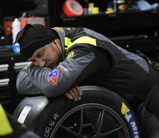 Crewman sleeping Rolex 24. (IMSA Photo)