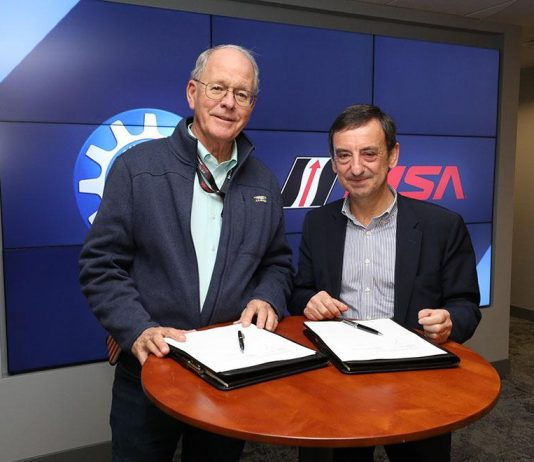 IMSA Chairman Jim France (left) and ACO President Pierre Fillon (right) pose for a photo prior to announcing the planned agreement between their two sanctioning bodies. (IMSA Photo)