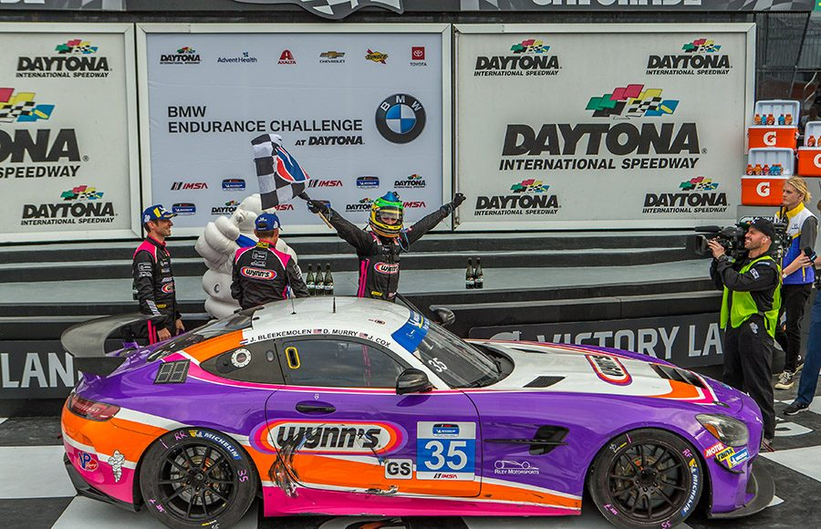 Dylan Murry, Jim Cox and Jeroen Bleekemolen celebrate after capturing the Grand Sport victory during the BMW Endurance Challenge. (Dallas Breeze Photo)