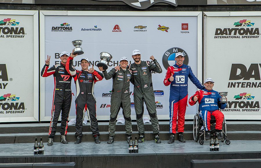 Gavin Ernstone and Jon Morley (center) won the TCR portion of the BMW Endurance Challenge Friday at Daytona Int'l Speedway. (Dallas Breeze Photo)