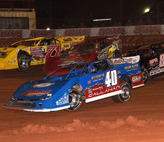 Joel Callahan (40), G.R. Smith (89), Pearson Lee Williams (2) and Hudson O'Neal battle four-wide during Saturday's Lucas Oil Late Model Dirt Series opener at Golden Isles Speedway. (Paul Arch Photo)