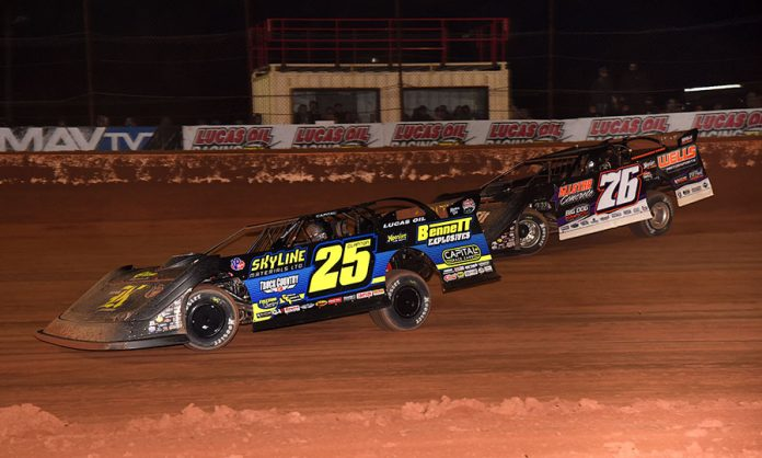 Shane Clanton (25) battles Brandon Overton during Saturday's Lucas Oil Late Model Dirt Series opener at Golden Isles Speedway. (Paul Arch Photo)
